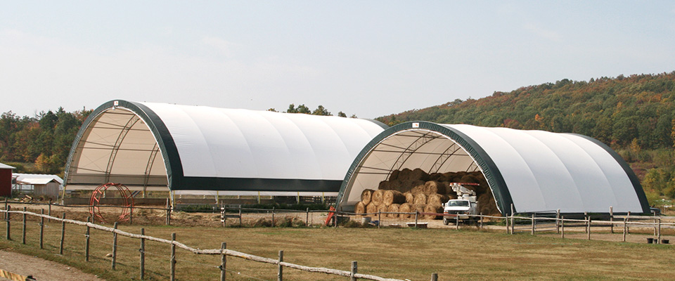 Fabric hay storage building