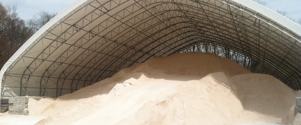 Clear span fabric structure