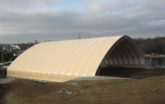 Beige Fabric building for Charcoal Storage